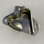 image of a metal door latch manufactured at Integrated Components machine shop